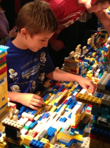Adding to the Lego Sculpture at the Exhibit