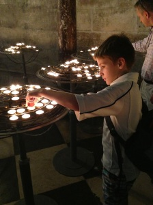 Lighting a candle for the departed in Notre Dame