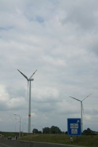 Two Wind power machines on the edge of the Port of Antwerp toward Ekeren.