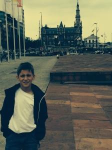 Behind me is the Port of Antwerp Custom House or Deurne.