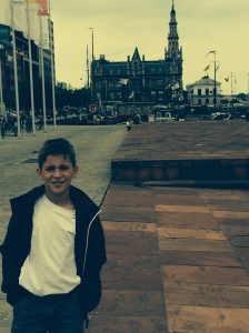 Behind me is the Port of Antwerp Custom House or Deurne.