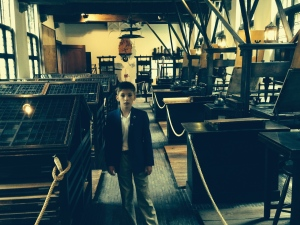Me in the Printing Press Room.  Typesetting on the left and printing presses on the right.