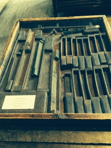 A box of 17th century typesetting tools they used to put and secure type into the forme.
