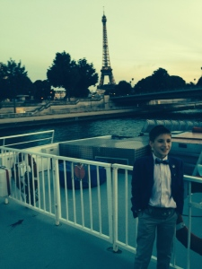 Me on the observation deck of our Bateaux Mouche with the Eiffel Tower in the background.