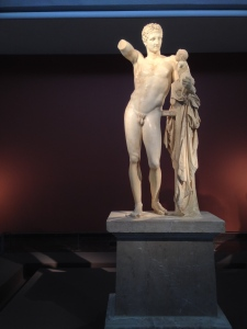 A Statute of Apollo holding Dionysius in the Museum at Olympia.