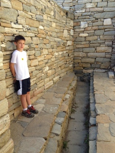 Here I am standing in the main toilet area of Delos.  People used the trench and it ran down into the sewer.  All the homes had toilets and sewers that emptied into mains that ran to the sea.  This was like 3,000 years before Christ.