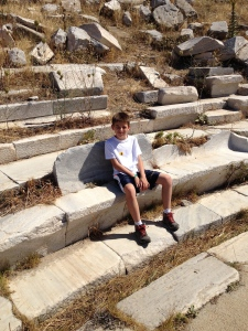 This is the ampitheater of Delos.  It is Greek because the first seats are at ground level.  If Roman, they would be 2 to 3 meters off the floor to start because they used wild animals like Lions and Tigers.