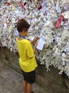 "Outside St. Mary's House on a terrace wall they write notes of ""wishes and hopes"" to tie onto ropes hanging on the wall.  I wrote for ""peace and happiness"" in all our lives."