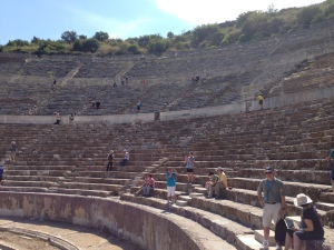 "The main and largest theater in Ephesus seats 25,000 people.  They had tickets which were little round stones, one with a smiley face for comedies and a sad faces for tragedies.  On the back of the stone was your seat number.  There is a smaller one (Odeon) which was also used as a ""congress""."