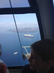 Going up to Fira, Santorini by cable car with our ship in the harbor.