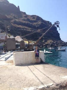 This is an old crane in the Ammoudi harbor that was used to lift baskets of fish from the boats when they came in.