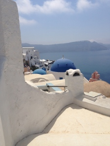 Only the churches have blue domes.  Here are two in Oia.
