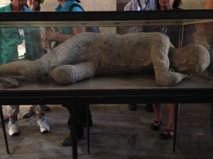 A molded copy of one of the intact bodies found under the ashes when excavating Pompei.
