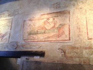 "Inside the ""love"" house, are these wall paintings of love scenes which survived the eruption and ash."