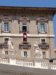 Up in the window is the Pope addressing the crowd of 150,000 in St. Peter's Square.  He spoke in Italian.
