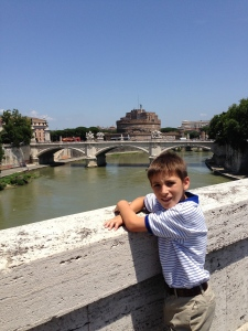 On a bridge over the Tiber with the Castelli San Angelo in the background.  On our way back to Via Arcenio via the Piazza Navona area where we will have lunch.