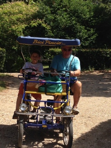 My dad and I on the Rició in Park Borghese.  You pedal and the electric motor kicks in.  I had to do this bike ride as soon as I saw it on our first day in Rome.