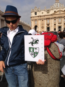 Here is Fred Hollywood aka Joe Cool in St. Peter's Square ready for the Papal Audience.  I am holding a sign my Dad made showing the school initials and logos.