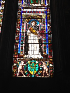 A stained glass window to St. Thomas Aquinas behind the altar at Santa Maria Novella