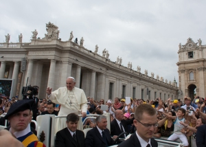 The Pope was always smiling and waving to crowd and sometimes he would stop and hug someone or give them a handshake.