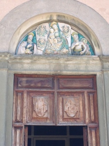 A door way arch with a beautiful bas relief fresco.