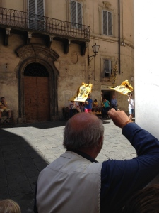 Flag Waving is a big part of the Siena Palio.  Here two guys are practicing their flag waving to the beat of a drummer you can't see.